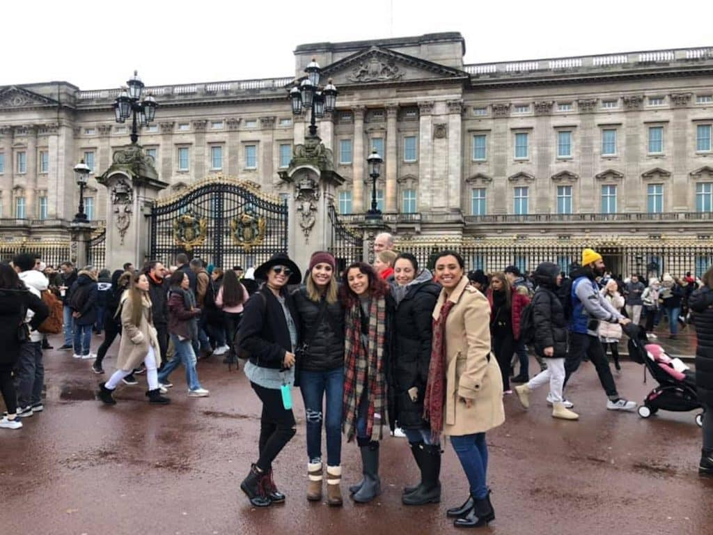 A trip to Europe was part of Jenn's Bucket List. They're in London at Buckingham Palace.