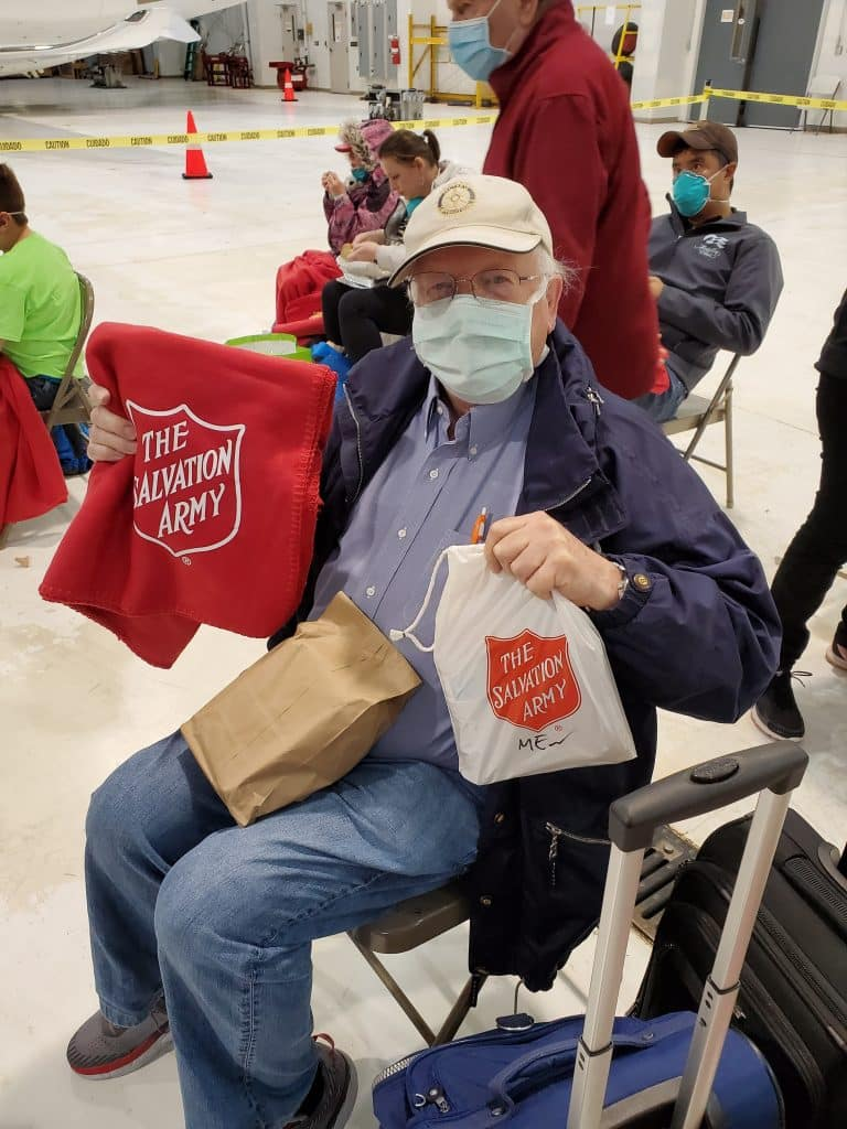 Buddy and Bonnie Sims' Big Adventure is almost over. They're back home in the Vail Valley after 16 days in quarantine. That's Buddy behind that mask. The Salvation Army met them at Denver International Airport.