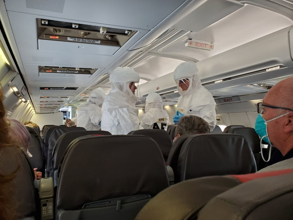 Even these doctors wore hazmat suits during the flight from San Diego to Denver.
