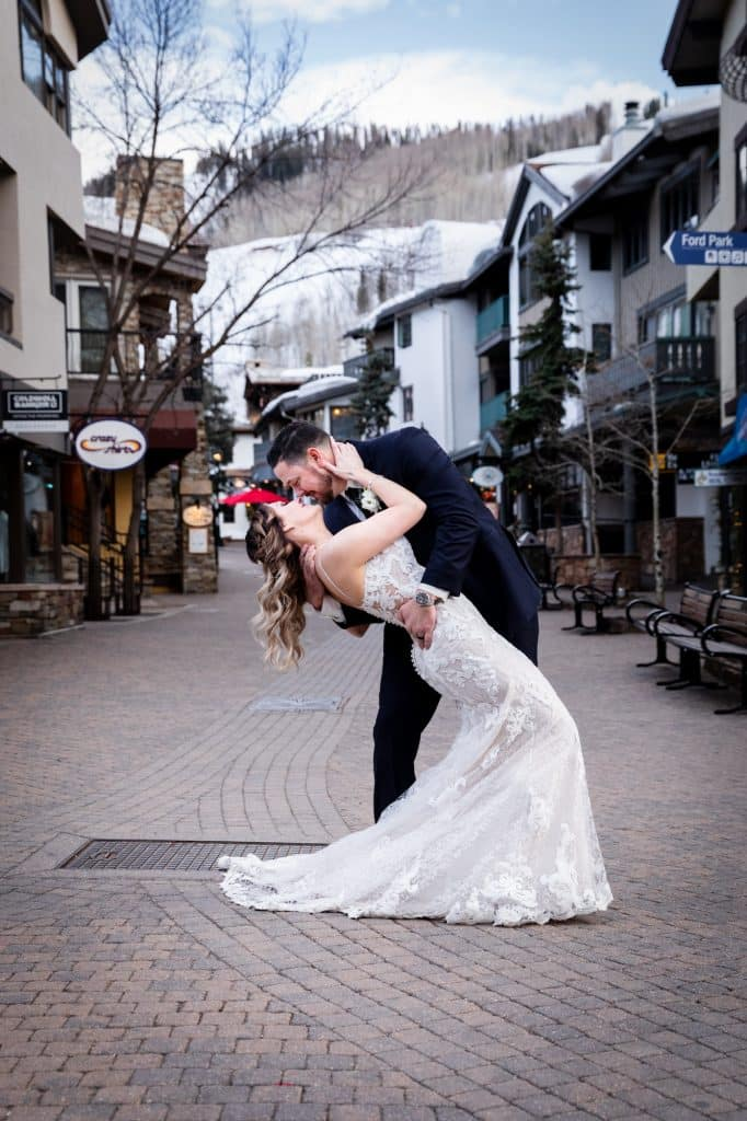 Todd Mitchell and Megan Carmichael pose on an empty Bridge Street in Vail. The couple from Florida eloped in Vail on March 15, a day after Vail Mountain was closed due to the coronavirus.