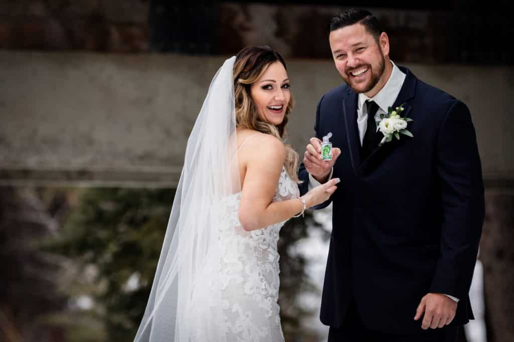 Todd Mitchell and Megan Carmichael showed they had a sense of humor by carrying hand sanitizer on their wedding day, which was on March 15, the day after Vail Resorts closed all of it's North American ski resorts due to the coronavirus.