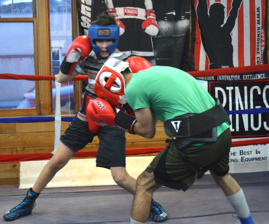 Jaime Chavira spars with Roberto Castillo as they tune up for next week's state Golden Gloves tournament.