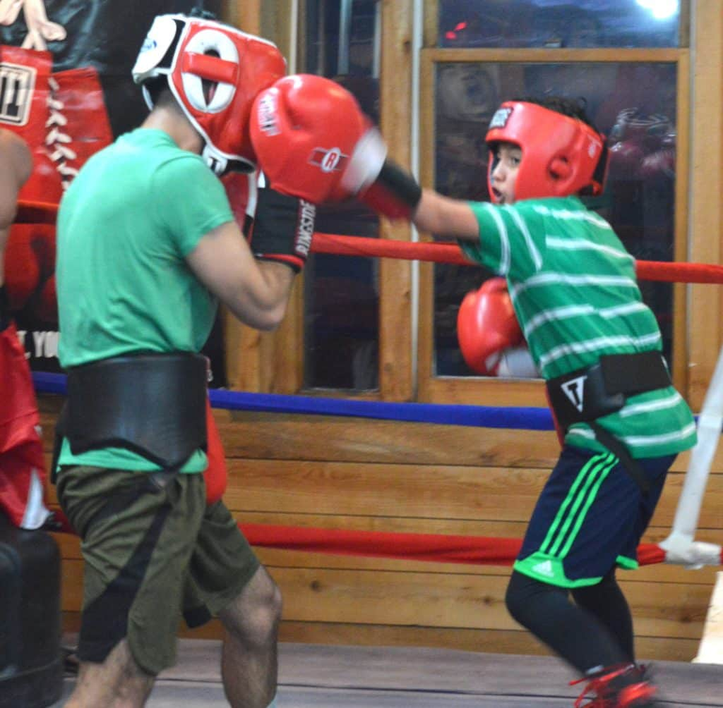 Sometimes Pisciotta has little guys spar with bigger guys, because sometimes in life they have to. That's David Muruato comporting himself admirably against sparring partner Roberto Castillo.