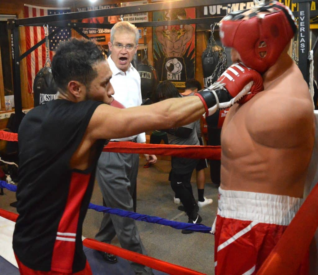 Mike Pisciotta, in the white shirt, launched Mean Street boxing club three years ago in Eagle. That's Francisco Gomez practicing his technique. Gomez blew out his shoulder in last year's Golden Gloves tournament, but kept fighting and almost won anyway.
