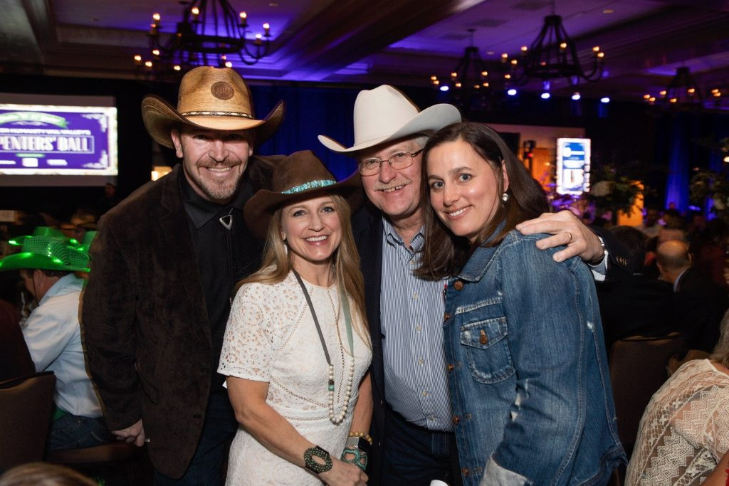 Chris Pryor (far left) and Elyse Howard (far right) of Habitat for Humanity Vail Valley pose with long time emcee Tricia Swenson (center left) and long time auctioneer Chuck Miller (center right) at last year's event.