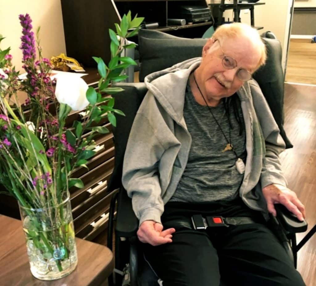 Vintage Magnolia in Edwards delivered a bouquet of flowers to each Castle Peak resident. That's Bill Metz.