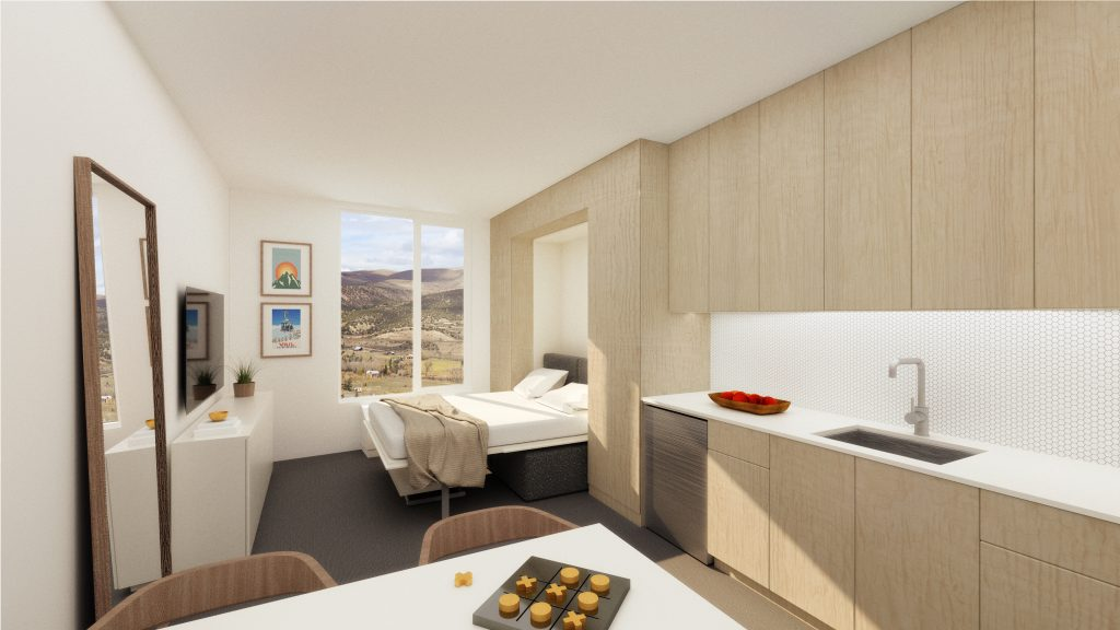In this rendering, the Murphy bed for a mtn hive unit is pulled down. Developers noted that the current exterior renderings for the building are being revised to show changes that have been made to the plan.