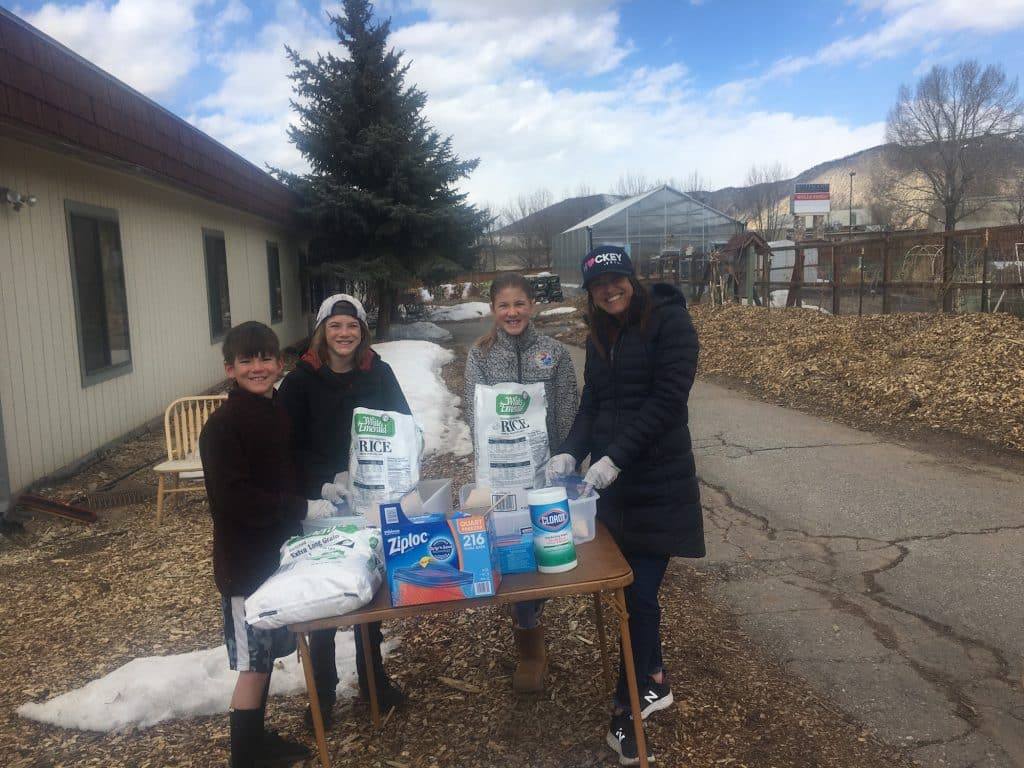 The Holton family helps pack rice from large bags into smaller quantities at the Vail Valley Salvation Army on Wednesday.
