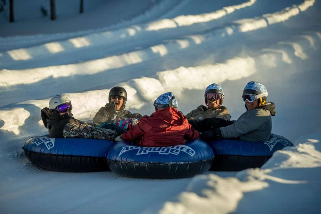 In addition to skiing and snowboarding, the veterans and their families do other activities like tubing and bowling.