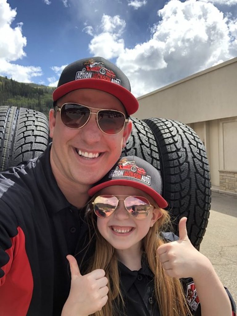 Ross Blankenship, owner of Action Jackson Auto, poses with his daughter, Jackson, in front the the shop in Eagle-Vail.