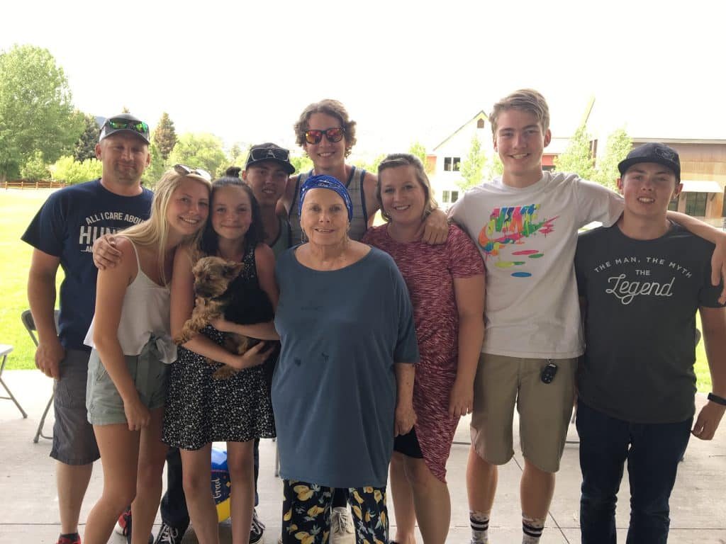 Pam Schultz was a proud grandmother as she gathered with her eight grandkids on the Lundgren Theater stage last summer.
