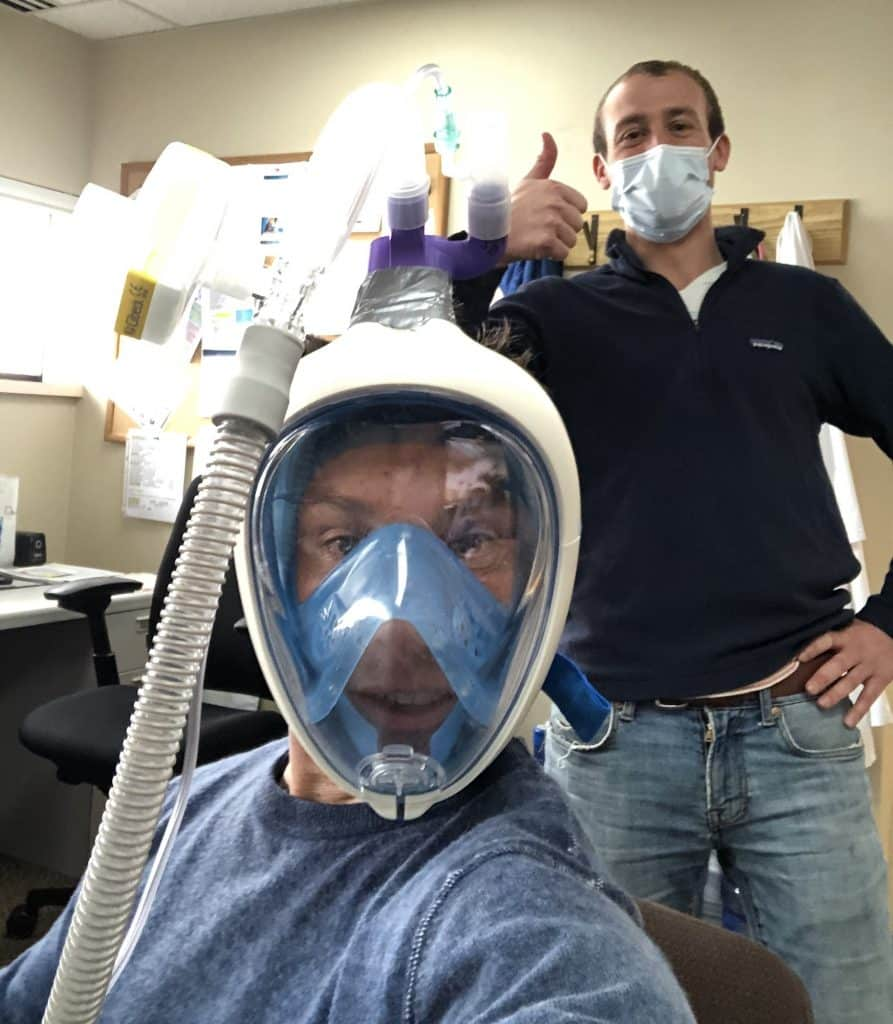 Dr. Dave Hile and Grant Gary show off a mask that helps COVID-19 patients breathe, instead of being forced to stick a tube down their throats for a ventilator.