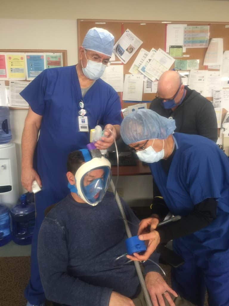 Dr Dave Hile and Dr Suresh Khilnani working with their creation.