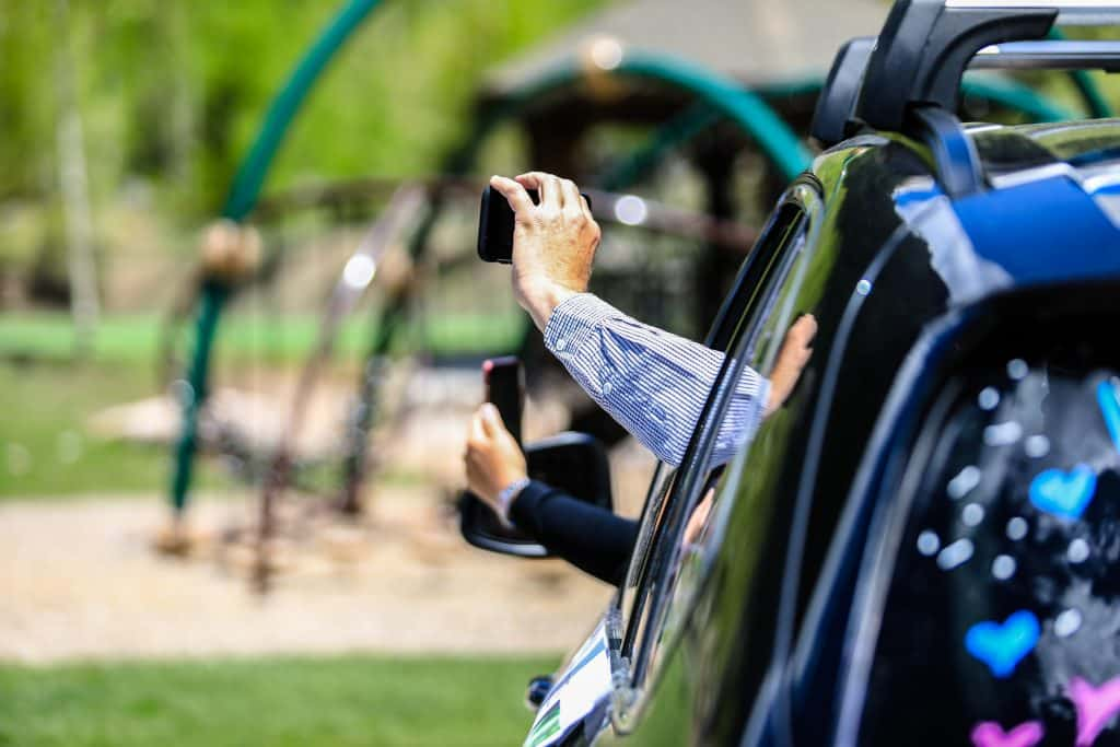 A parent records from a cell phone Saturday during a drive-in ceremony celebrating Vail Mountain School's Class of 2020.