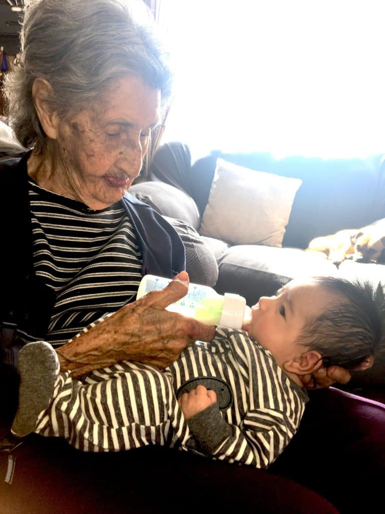 """Cordelia """"Cordy"""" Leyba-Lovato celebrates her 100th birthday on Mother's Day. She's holding Xavier, one of her 45 great-grandchildren. Leyba-Lovato lives in Red Cliff with her granddaughter Georgetta Sandoval-Stevens."""