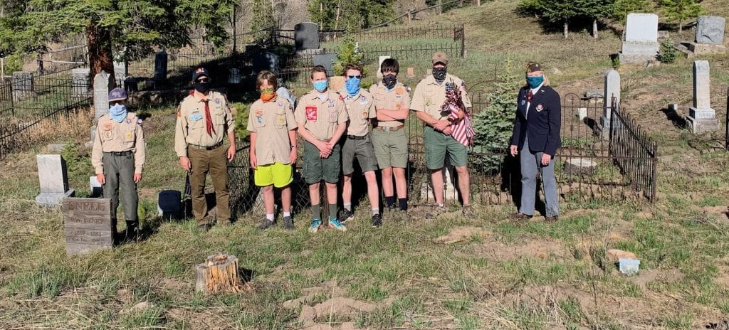 Scouts from around Eagle County planted flags at the grave markers of military veterans in cemeteries around the county. These are Scouts from Troop 231. They placed a flag at the gravestone of a Spanish American War veteran in Red Cliff.