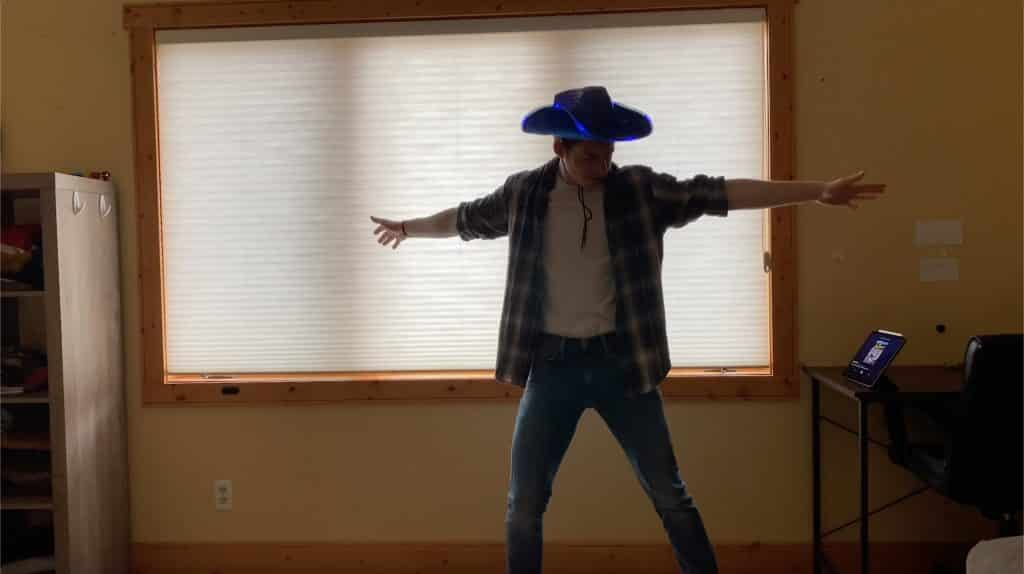 """Vail Christian High School student Samuel Jaffe dons a cowboy hat to look the part of his character in """"Footloose the Musical."""""""