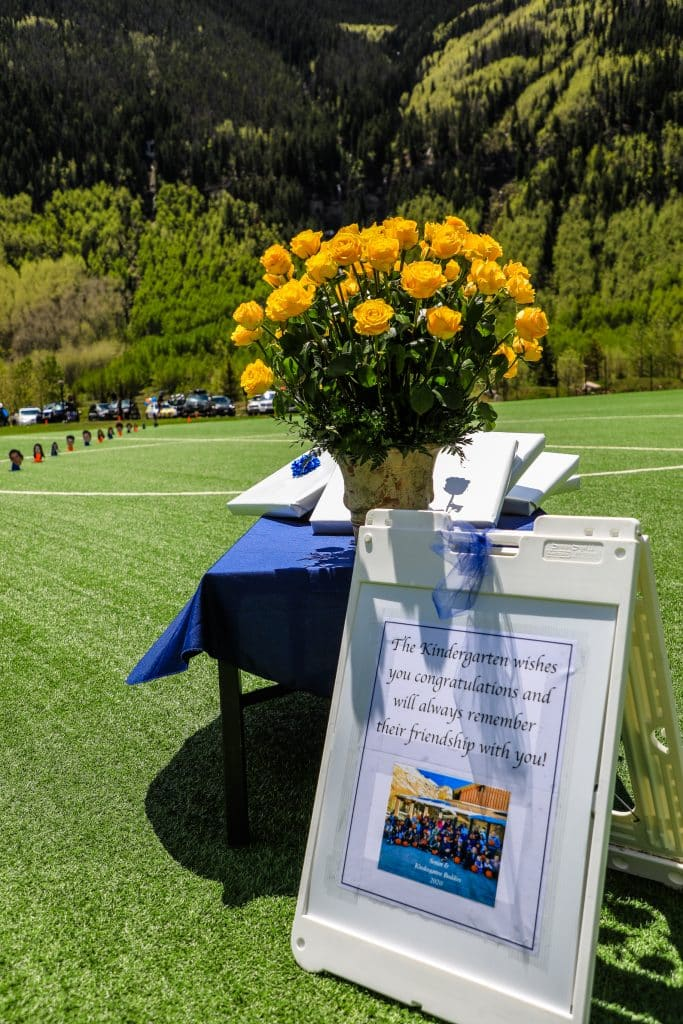 Flowers normally given by kindergarteners are taken by seniors for VMS graduation Saturday in East Vail.