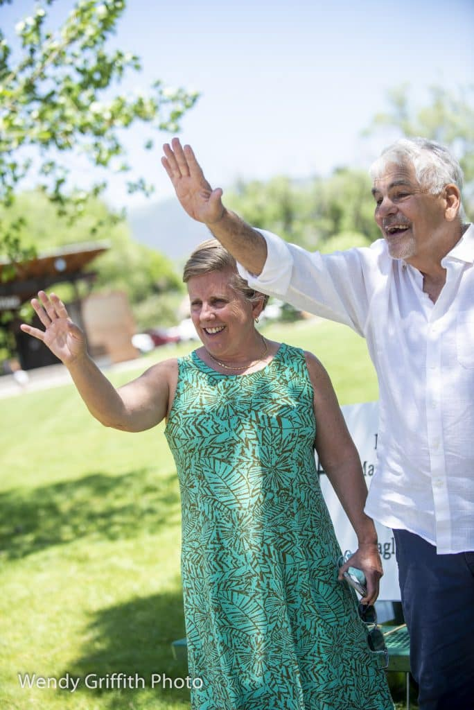 The Rev. Sid Spain, together with his wife Robyn, waves to a parade of well wishers during a special, COVID-19 adapted, drive-by party held last weekend at Eagle Town Park. Spain is retiring as pastor of the Eagle Community Methodist Church and will preach his final sermon July 5.