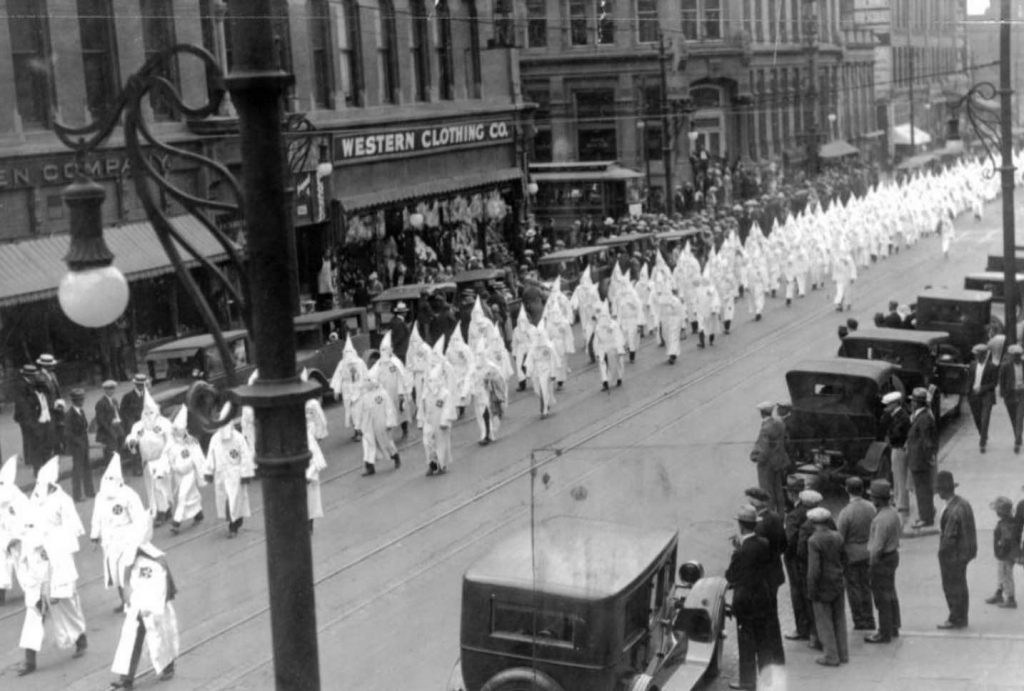 KKK clansmen march down Larimer Street in Denver in 1926.
