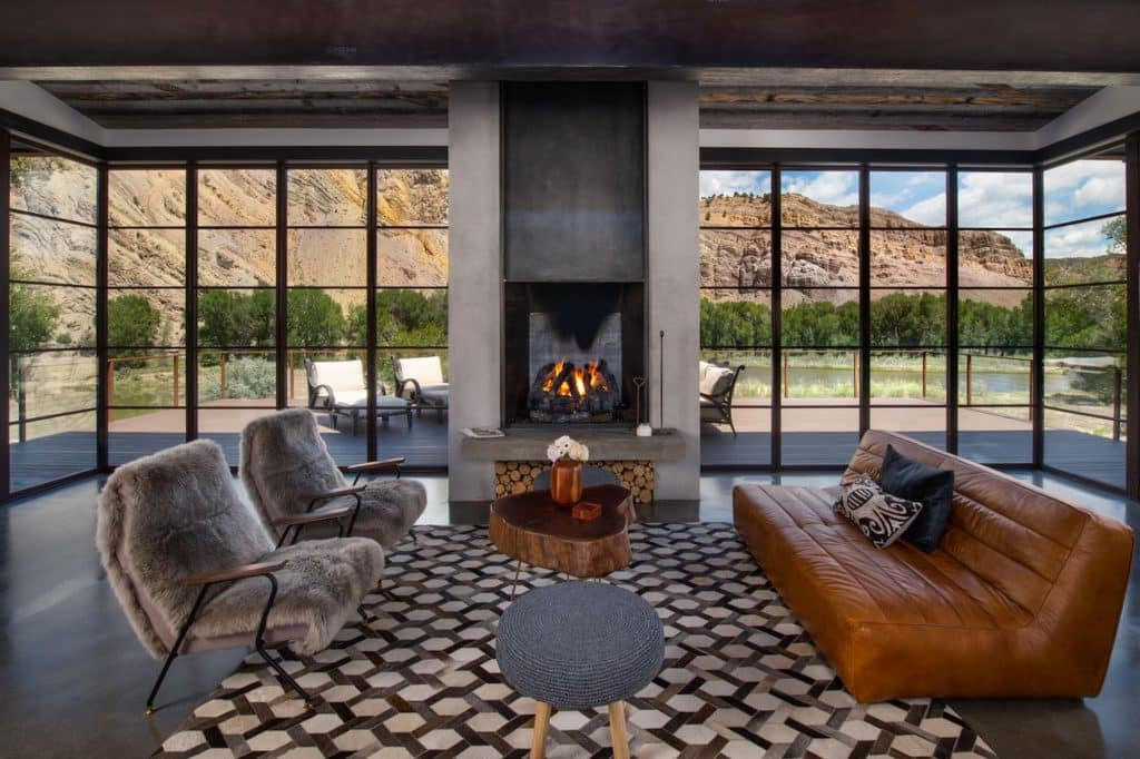 The 5,800-square-foot Bunkhouse is a luxurious mountain-modern, six-bedroom home with six and a half bathrooms. The design is open, with a natural flow between the bedrooms and common areas to intentionally gather family and guests into one central space.