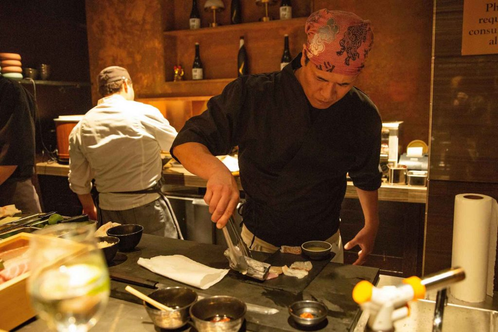 """Can't decide what to order? Let chef Yoshikazu """"Kazu"""" Ebina prepare a four-chair omakase experience for your group."""