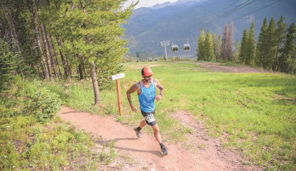 A racer runs up Vail Mountain during the 2019 Berry Picker Trail Run.