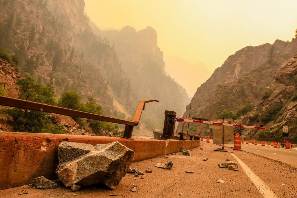 Falling rocks continue to pummel Glenwood Canyon as the fire moves away Sunday near Glenwood Springs. With the vegetation burned away, nothing is there to anchor the rocks to the mountainside.