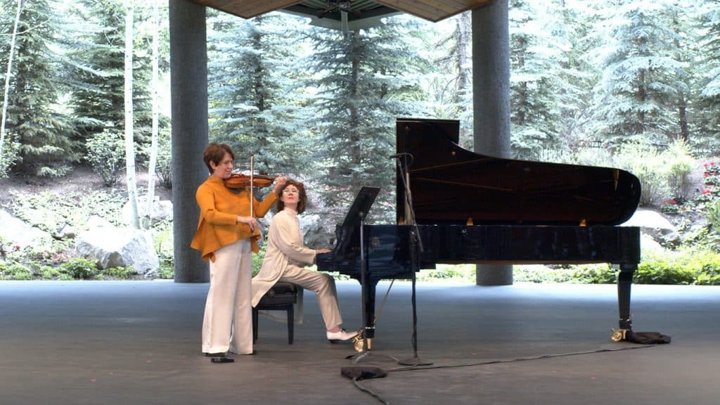 Bravo! Vail artistic director, Anne-Marie McDermott accompanies founding artistic director, Ida Kavafian as they perform the at the Gerald R. Ford Amphitheater during Bravo! Vail's abbreviated schedule this summer. This year marked McDermott's 10th year at the helm of the festival.