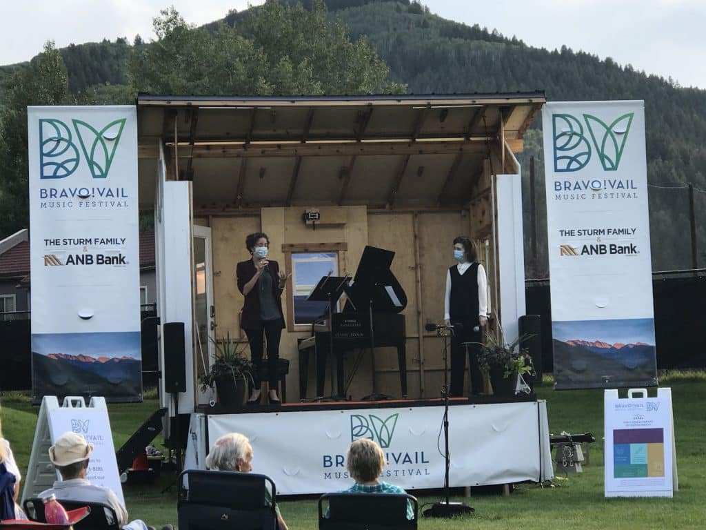 Caitlin Murray, left, executive director for Bravo! Vail and Anne-Marie McDermott, artistic director for Bravo! Vail address a small group from The Music Box on July 27 at the Eagle-Vail Pavilion.