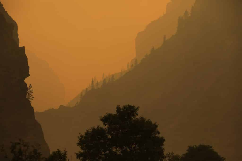 Smoke hangs low in Glenwood Canyon as a result of the Grizzly Creek Fire Sunday near Glenwood Canyon.