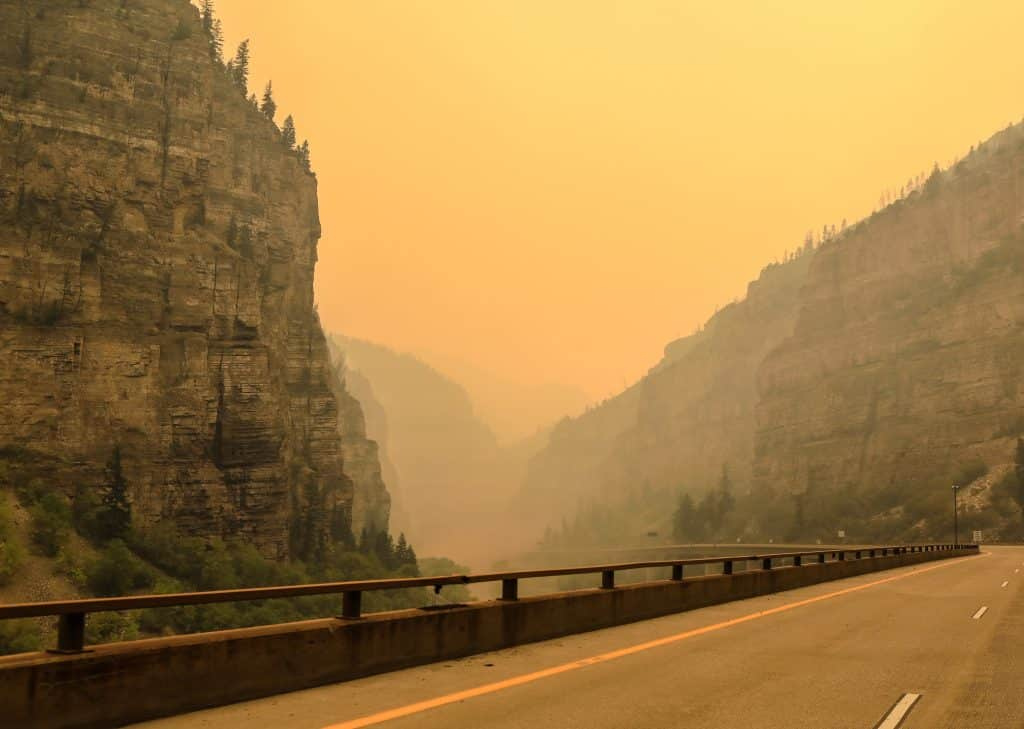 Smoke sits low in Glenwood Canyon Sunday near Glenwood Springs on Aug 16. Interstate 70 reopened early Monday morning.
