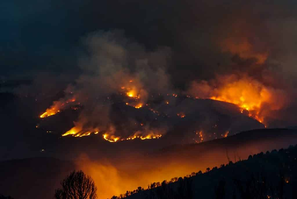 The Grizzly Creek Fire glows overnight.