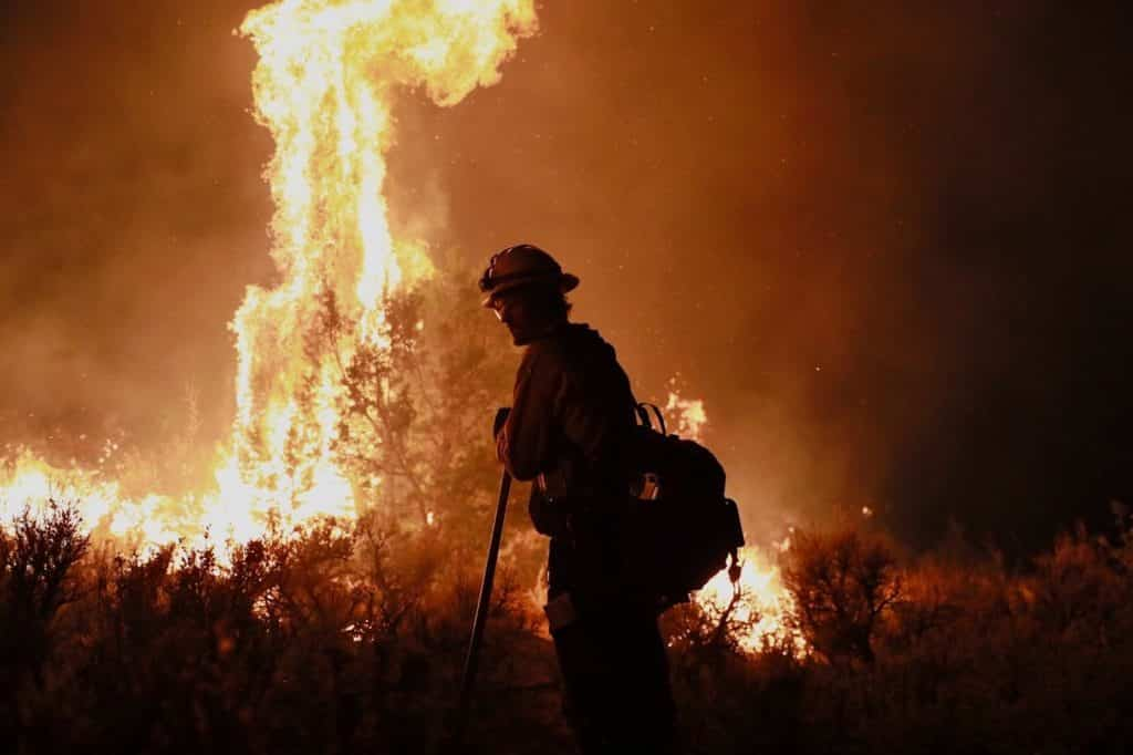 A firefighter works to hold the fire line at night on Aug. 15. The Grizzly Creek Fire is now at 4% containment.