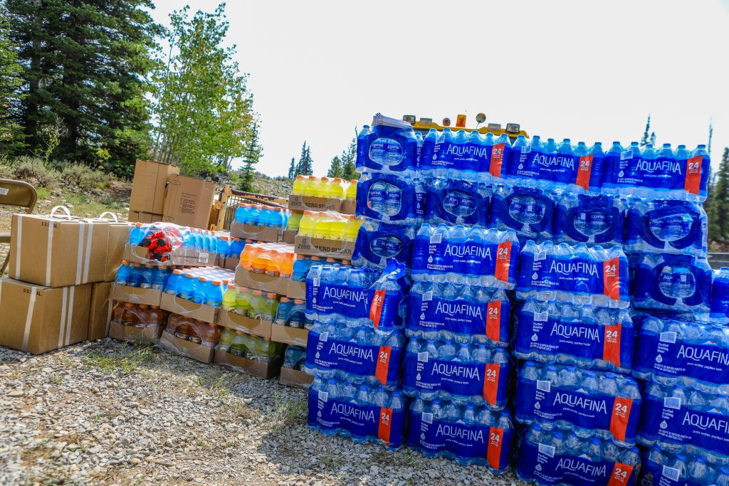 Supplies at the Coffee Pot Spike Camp Friday near Dotsero. Those fighting the fires are constantly reminded to stay hydrated in the hot and high terrain of Colorado.