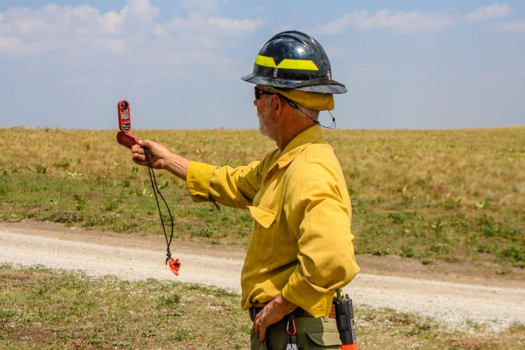 Steve Abbott with the U.S. Forest Service checks wind speed Friday off Coffee Pot Road near Dotsero. The wind picked up in the higher terrain, which helped fuel the fire.