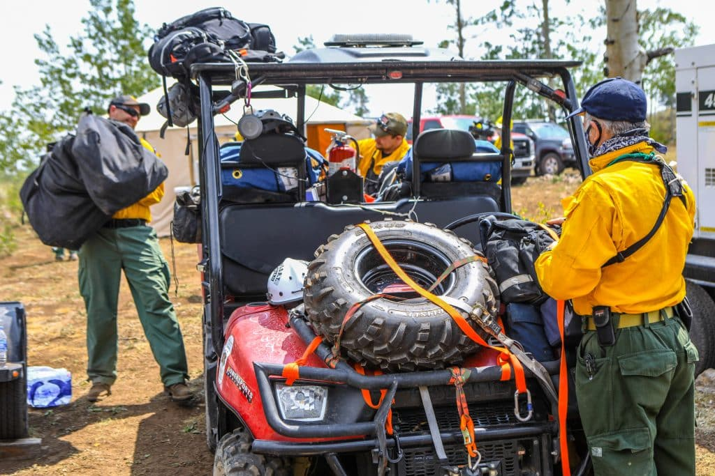 Crews load up to head out of the Coffee Pot Spike Camp into the field to fight the Grizzly Creek Fire Friday near Dotsero. Spike camps are used to keep crews close to the action so they don't have to travel long distances to the fire each way.