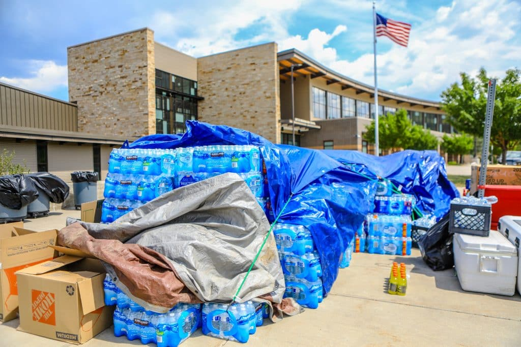 Water is stacked ready for deployment if needed at the shelter location Tuesday at BMHS in Edwards. The location was set up as a possible shelter for fire evacuees.