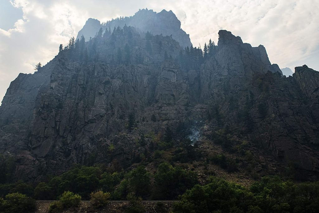 A small fire smokes on the hillside in Glenwood Canyon on Thursday, August 20, 2020. (Kelsey Brunner/The Aspen Times)