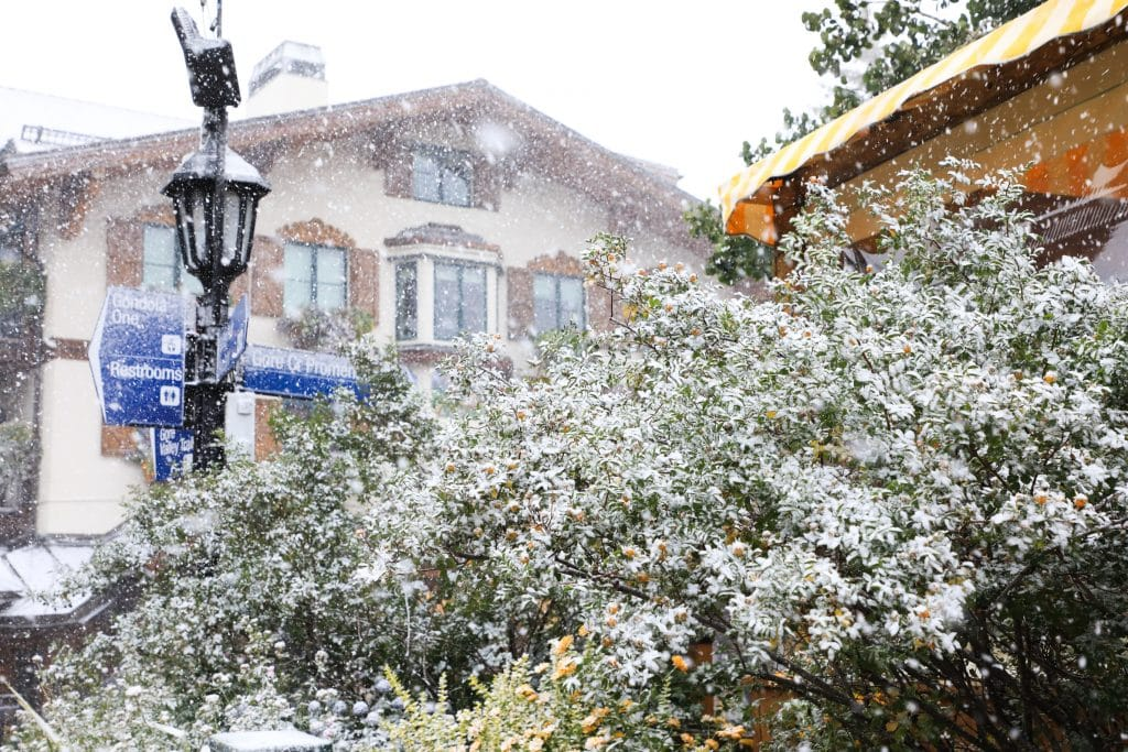Snow starts to fall in Vail Village.