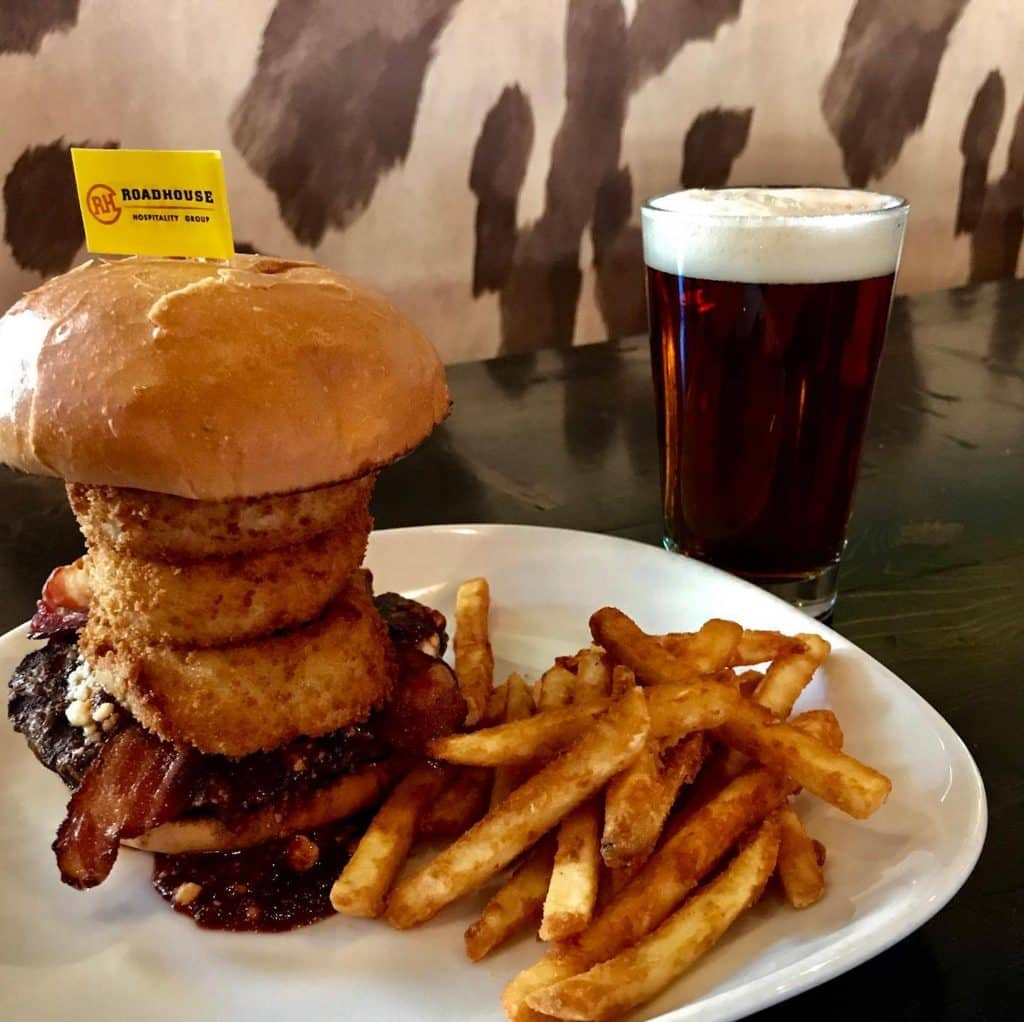 The Fat Burger at the Dusty Boot has onion rings piled on top of bleu cheese crumbles.