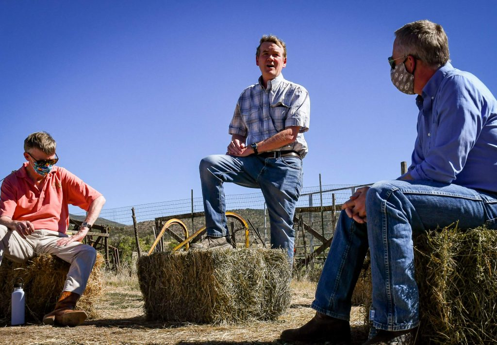 Sen. Michael Bennet alongside Sen. candidate John Hickenlooper speaks with local officials and community members at the Colorado Outdoor Recreation and Economy Act (CORE) event held at the Fales Ranch south of Carbondale on Wednesday afternoon.
