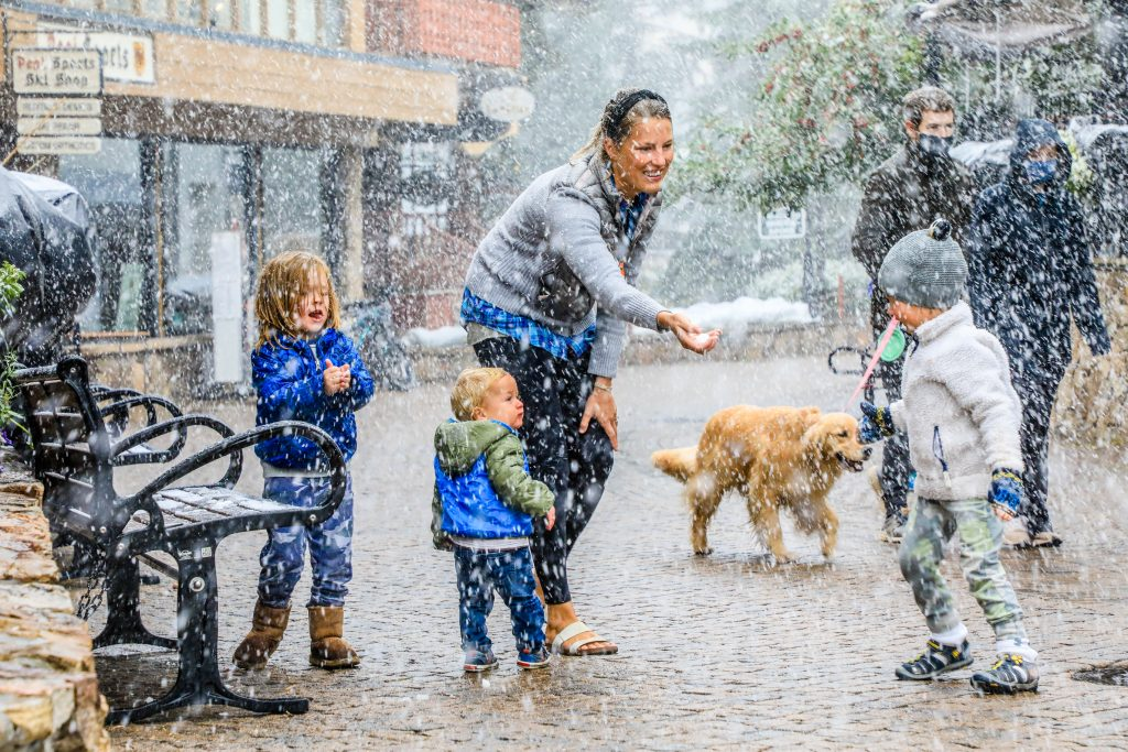 Megan Dillard, back, of Austin, Texas, plays in the snow and has a snowball fight with (from left) Sammy, 4, Hayes, 1, and Donald, 3, Dillard Tuesday in Vail. Snow came in heavy into the valley in the afternoon hours.