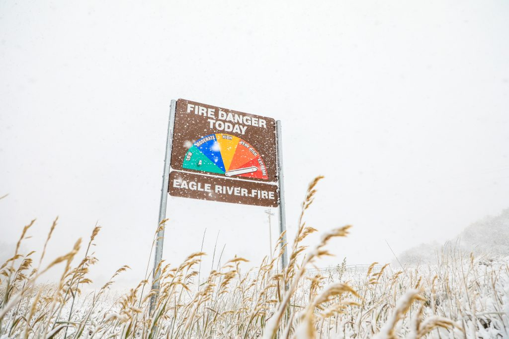 Weather changed quickly as the sign shows in the snow Tuesday in Minturn. The state had warnings from fire to freeze and in between the last day.