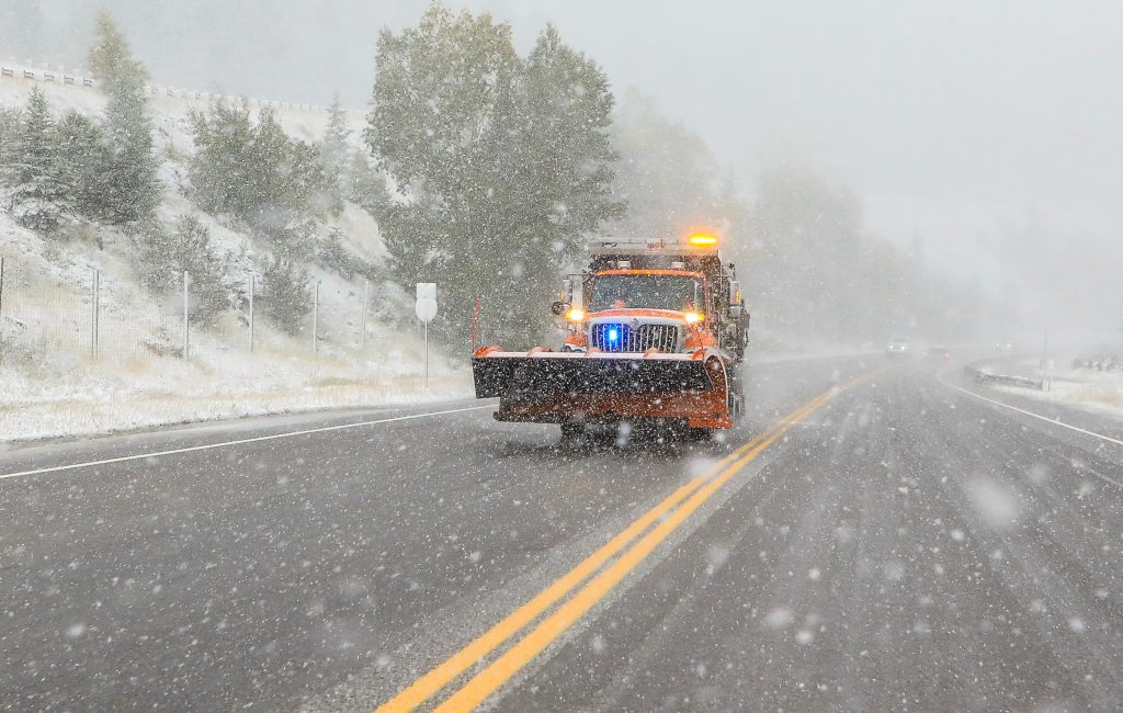 A snow plow makes its way down Highway 6 during the storm Tuesday near Minturn. Snow fell heavy in the afternoon hours.