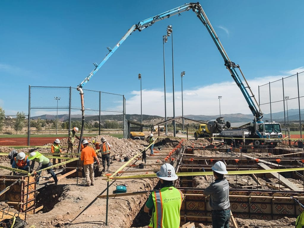 Workers with RA Nelson pour concrete for the foundation of a new building at the Eagle Sports Complex in Eagle, Colo. The building will include a new concession stand and restrooms and have shaded areas with picnic tables.
