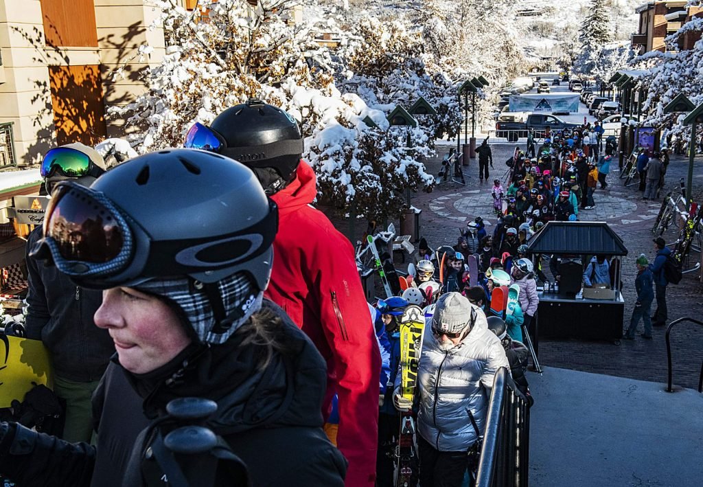 Hundreds of people wait in line to get on the Silver Queen Gondola for opening day at Aspen Mountain on Saturday, November 23, 2019. Masses of skiers and riders won't be allowed this season. (Kelsey Brunner/The Aspen Times)